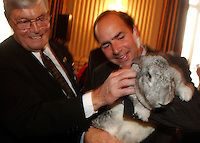 "Reps. Phil Crane and Zach Wamp play with ""Itty Bitty"" a 16lb. Flemish Giant Rabbit, at a reception celbrating the partnership between the American Zoo and Aquarium Association and the National Wildlife Refuge System in 2003."