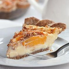 Use low-fat milk along with nonfat Greek yogurt in the creamy custard for this peach pie. Get the recipe for this Peach Custard Pie Recipe! | eatingwell.com