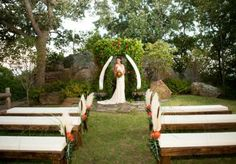 Exotic altar by Lasting Impressions at Skelly Lodge. Benches from Mood Party Rentals. Floral by Petal Pushers. Photo by Artworks Tulsa Photography. #wedding #altar #orange #outdoor