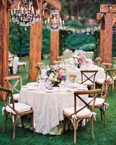 The Reception - After the ceremony, the 175 guests gathered in the garden for cocktails, and trollies shuttled attendees to the reception on the upper lawn. Wooden beams, crystal chandeliers, and cane chairs with cushions made an inviting outdoor room.
