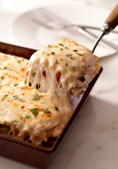 Creamy White Chicken & Artichoke Lasagna – You may never make your regular lasagna recipe again after trying this one—with shredded chicken, sun-dried tomatoes and artichokes in a rich, creamy white sauce.