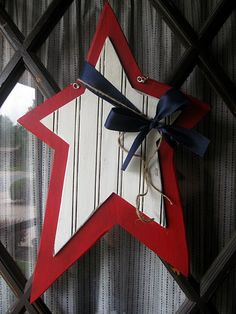 I want to make this!  Cute wood star for my front porch post