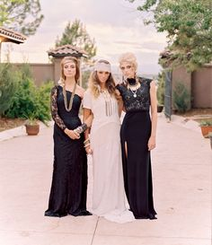 Bohemian bride + bridesmaids in black
