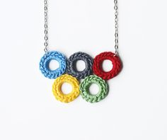 bubble jewelry olympic rings necklace. $14.00, via etsy.