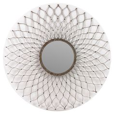 Metal wall mirror with a sunburst lattice frame.