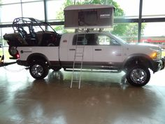 The grand prize winner's package included this Dodge Cummins Diesel 2500 Outdoorsman Truck with roof top camper and a Can-Am Commander.
