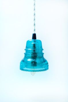 Vintage Glass insulator pendant lamp. Interesting idea for these.  I have always loved their color.