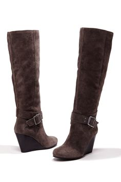 Knee-high boots with a stacked wedge, ankle wrapped detail with buckle, all-the-way-up side zipper and rounded toe.