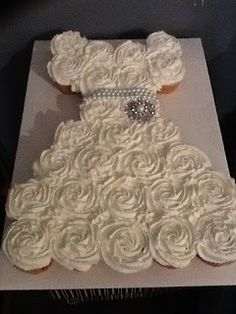 Pull-apart cupcake cake for Bridal Shower. Another good idea, decorate this princess style for a little girl's birthday!!