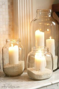 Recycled glass jars & white candles! Coffee beans around bottom of candles