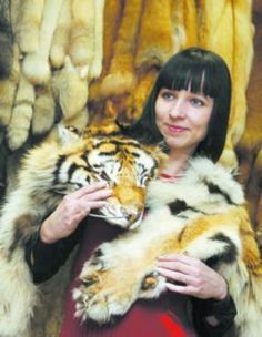 A real tiger fur and a real fake woman. Shame on you ugly hag! creature of the dark