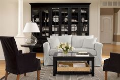 Oh my.. this is amazing.  I love the black bookcases, the pillowticking sofa.. love the clean lines.  So pretty. Found this through the Signature quiz at Ethan Allen, thanks to @Sherry @ Young House Love.