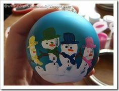 Handprint Snowmen Ornaments - A great excuse to get a little messy and jazz up a plain plastic ornament. #tutorial