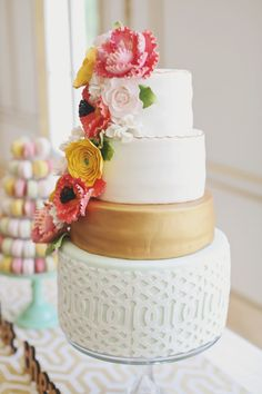 Stunning wedding cake: http://www.stylemepretty.com/2014/01/06/colorful-chateau-cocomar-wedding/ | Photography: Forever Photography - http://www.foreverphotographystudio.com/