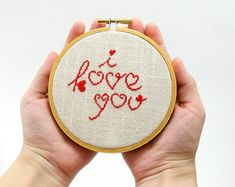 Cross stitch in wooden hoop I love you in red color