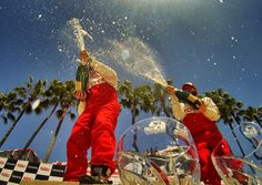 Champagne showers for the 2013 Toyota Pro/Celebrity Race Winners, Adam Carolla and Rutledge Wood.
