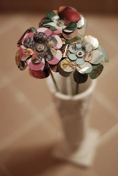 recycled, and could be made from coke cans, beer cans or any cold drink cans....