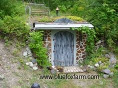 Choose a cordwood earth sheltered root cellar with a Sedum roof, built into the hillside.    Unusual and unique, this little root cellar stays at a comfortable 15-20 degrees Celsius in the summer, and above freezing in the winter, even without added heat. The cordwood walls on the front keep the temperature from fluctuating too much, making it the ideal place to store organic vegetables for the winter. Deep snow will help insulate it.