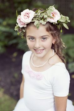flower girl with flower wreath // photo by Dreamlove Weddings, flowers by Petal Floral Design // http://ruffledblog.com/massachusetts-orchard-wedding