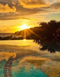 Go for a swim while watching the sun go down in San Juan del Sur  Nicaragua. resorts, san juan del sur nicaragua, eye resort, beauti sunset, travel, pelican eye, place, eyes, rising sun