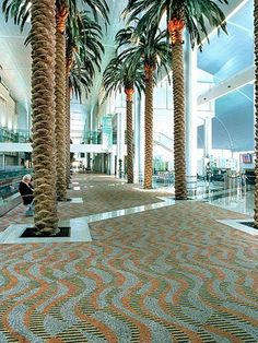 The #Dubai International Airport features a custom Colorweave Milliken floor covering, which compliments palm trees that bring the country's vibrant outdoor environment inside.