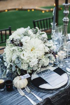 white floral centerpiece, photo by Analisa Joy http://ruffledblog.com/til-death-do-us-part-styled-wedding #weddingideas #centerpieces