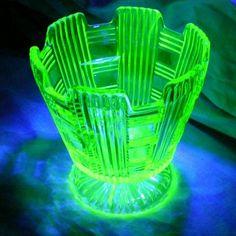 Vaseline glass vase. I love the way it glows under black light.