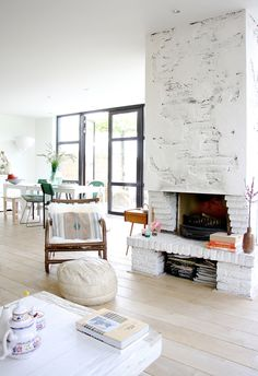 Living room with fireplace via Avenue Lifestyle