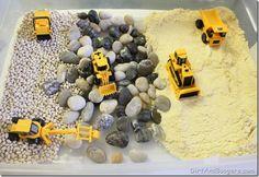"Construction Site - white beans, river rocks/pebbles, cornmeal, trucks ("",)"