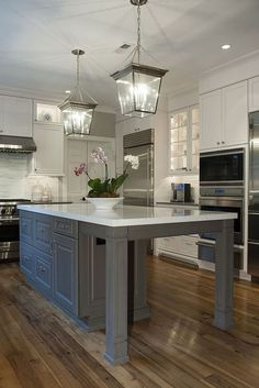 Love the lights & the flowers!  Home talk :: Kitchen Remodel in Glen Mills, PA