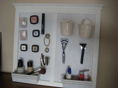 finally finished it! Made my on magnetic makeup holder and bathroom organizer. his n' hers