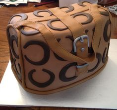 Fondant Coach Purse - Edible cake made to suit a customers request. Other designs, colors, and styles available too at www.frostingcupcakery.com