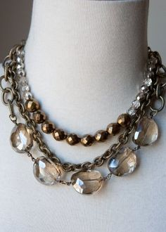 "Mixed metal chain, glass cut crystal, matt bronze & smoke glass. Length: 16""-19"""
