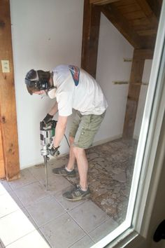 Here's all about removing baseboard trim and how to use a hammer drill-- nitty-gritty details about tile removal from  @Sarah M. Dorsey Designs.