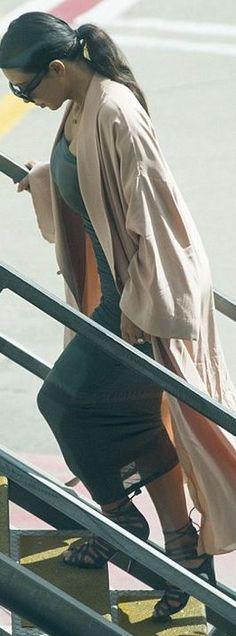 Kim Kardashian: Dress – Wolford  Shoes – Tom Ford  Sunglasses – Saint Laurent