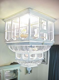 Redecorating by Repurposing • Lots of Ideas and Tutorials! • Including this diy birdcage light from design sponge.