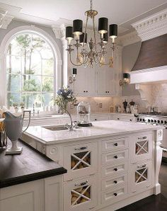 This custom furniture-style island features bin storage. - Traditional Home ®