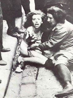 The photo is one of a series showing women being stripped, harassed and chased by civilians as chaos led to rapes and killings after the Germans captured Lviv Ukraine from the Soviets. 1941