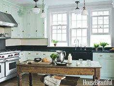 Kitchen of the Month, November 2012. Design: Young Huh. housebeautiful.com. #kitchen #green #farmhouse #vintage_lighting #pendant_lights