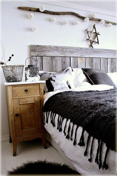 Rustic DIY headboard I like how they did a big chunky throw over top of the white bedding to provide accent color.  Non traditional accent table for bedside.  50 Rustic Bedroom Decorating Ideas