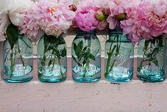 blue mason jars with pink flowers