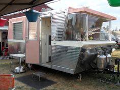 Vintage trailer with wrap-around window