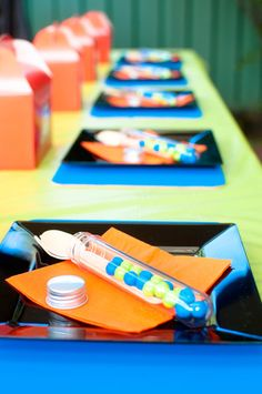 Table settings at a Mad Scientist party!  See more party ideas at CatchMyParty.com!  #partyideas #boybirthday