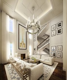 Great high ceilings, lighting, wall art, rug and staircase zigzagging in the background...