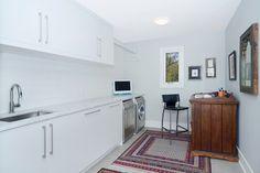 Contemporary laundry room by Johnson & Associates Interior Design