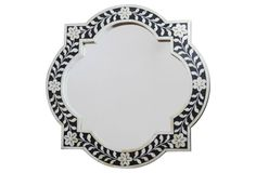 Love the black and ivory bone inlay on this mirror.