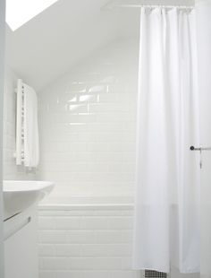 clean white subway tile and misty aqua walls for my bathroom