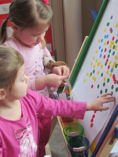 Using colored sticker dots for collaborative, creative process art-awesome for fine motor development!