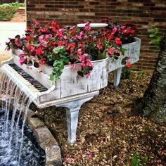 Photo: I love this idea. I would rather see an old piano recycled into something purposeful as opposed to the landfill.  I would definitely remove the ivory keys before doing this and save them for another decorating idea.