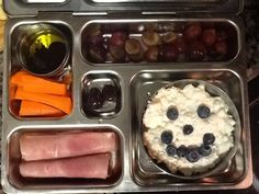 Lacto-Paleo lunch: carrots w/evoo and vinegar dip, grapes, cottage cheese with blueberries, ham roll ups, and 2 chocolate covered almonds <2